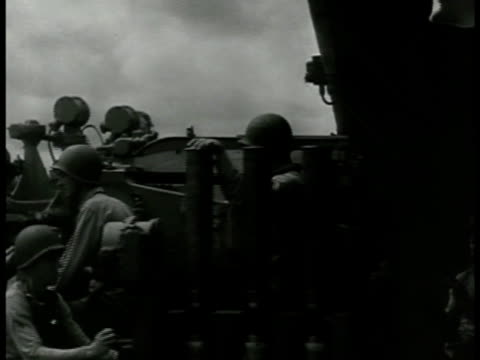 stockvideo's en b-roll-footage met soldiers standing by battleship guns us soldiers on turning turret battleship firing guns repeatedly td smaller ship's guns firing us soldiers firing... - 1943