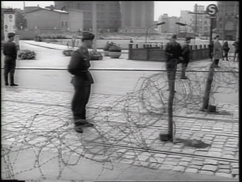 soldiers standing guard at barbed wire fence of berlin wall / germany / newsreel - 1961 stock videos & royalty-free footage