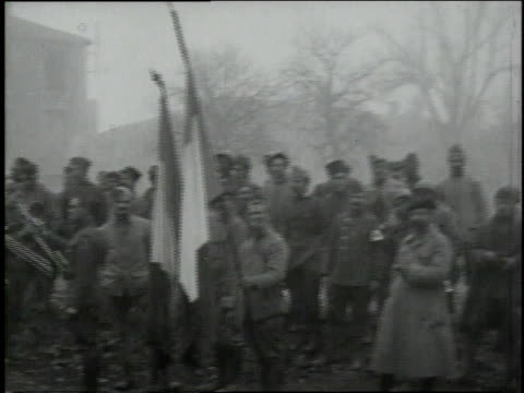 soldiers standing in group as band plays / verdun lorraine france - anno 1918 video stock e b–roll