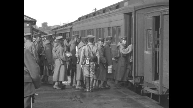 soldiers standing on platform beside train cars / soldiers getting on train / two shots of train leaving people on platform waving at soldiers on... - 1928 stock videos & royalty-free footage