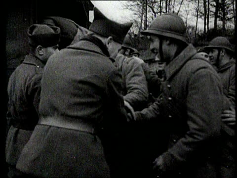 soldiers stationed at the maginot line receive leave-passes and board a train - maginot linie stock-videos und b-roll-filmmaterial