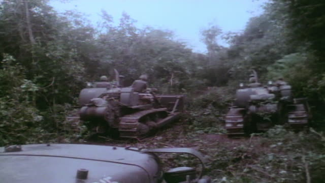 soldiers supervising bulldozer flattening jungle brush / vietnam - desaturated stock videos & royalty-free footage