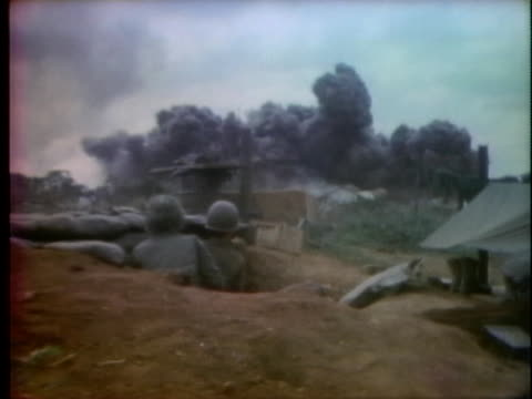 soldiers take cover in a fox hole during the battle in dat do, south vietnam. - south vietnam stock videos & royalty-free footage