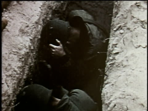 US soldiers take cover in bunkers as bomb explodes in the desert