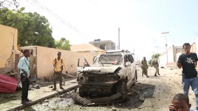 Soldiers take security measurements following twin car bombings outside the UN's office in Mogadishu on July 26 2016 At least 12 people were killed...