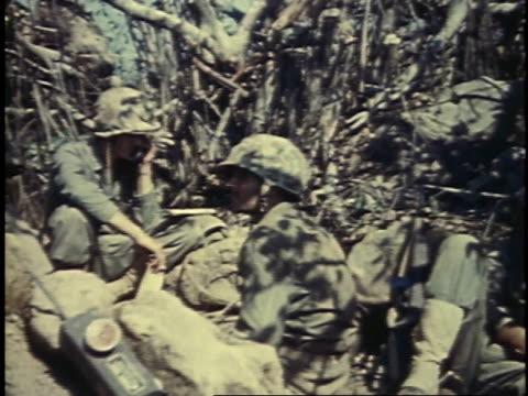 soldiers talking on phone / iwo jima, japan - battaglia di iwo jima video stock e b–roll