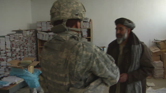 soldiers talking with civilians / mausa qala, helmand province, afghanistan. - civilian stock videos & royalty-free footage