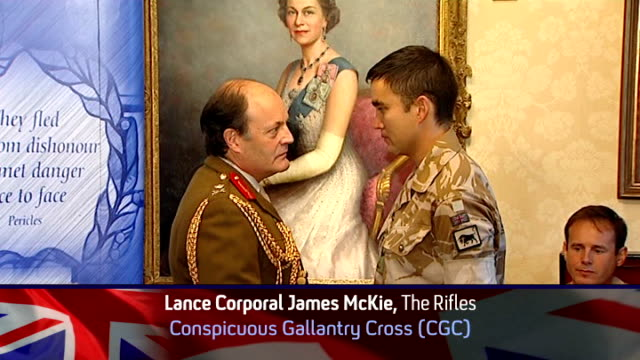 soldiers to be honoured for bravery int lance corporal james mckie conspicuous gallantry cross shaking hands with interview overlaid sot - the conspicuous gallantry cross stock videos and b-roll footage
