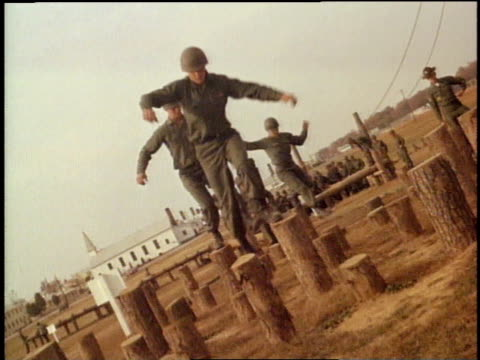 1967 montage soldiers training and running obstacle course / fort campbell, kentucky, united states - army exercise stock videos and b-roll footage