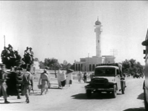 stockvideo's en b-roll-footage met b/w 1956 soldiers truck women on road with mosque in background / sinai peninsula / suez crisis - suezcrisis