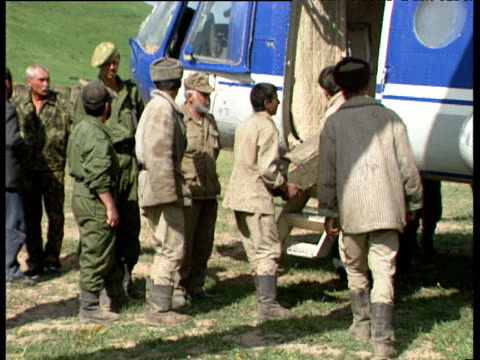 soldiers unload ammunition crates from first aid helicopter during tajikistan civil war tajikistan 1992 - ammunition stock videos & royalty-free footage