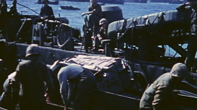soldiers unloading a ship and view through an lst during world war ii - ammunition stock videos & royalty-free footage