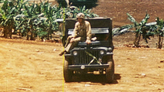 soldiers unloading patients from military jeep ambulances / saipan mariana islands - mariana islands stock videos and b-roll footage