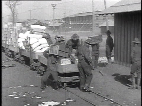 soldiers unloading supplies from a small train in camp / camp sherman chillicothe ohio united states - chillicothe stock videos & royalty-free footage