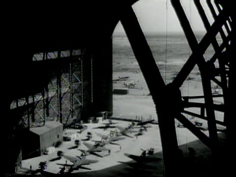 us aircraft soldiers unwrapping us bomber outside hangar int hangar w/ airplanes in rows allied mechanics assembling military airplanes us fighter... - westbengalen stock-videos und b-roll-filmmaterial