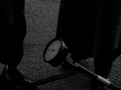 soldiers use a pedometer to measure the distance of the coronation procession 1953 - 1953 stock videos and b-roll footage