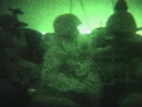 soldiers view bombs through a night vision lens during night patrol in fallujah. - al fallujah stock videos & royalty-free footage