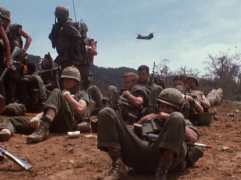 us soldiers wait for transport helicopters to land in vietnam - vietnam war stock videos & royalty-free footage