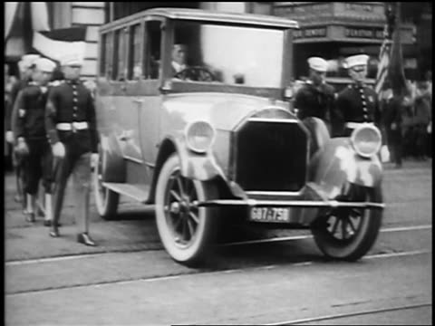 b/w 1923 soldiers walk beside hearse in president harding's funeral procession / san francisco - hearse stock videos & royalty-free footage