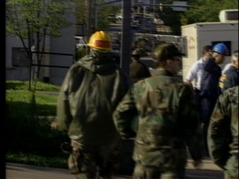 soldiers walk down the street near the site of the bombing of the a.p. murrah federal building in oklahoma city. - oklahoma city bombing stock videos & royalty-free footage