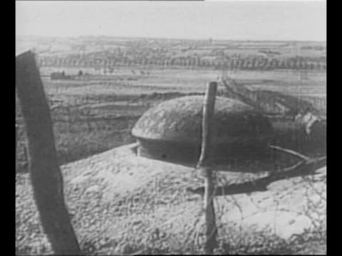 soldiers walk near an ouvrage at the maginot line in france during world war ii / gun turret rises from the ground at the maginot line / slits in... - french army stock videos & royalty-free footage