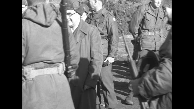 soldiers walk past and shake cardinal francis spellman's hand / group of soldiers, one woman and five men in berets talk and laugh / soldier in... - vangen bildbanksvideor och videomaterial från bakom kulisserna