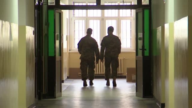 soldiers walking corridor - army soldier stock videos & royalty-free footage