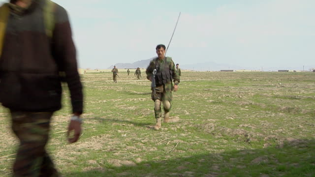 soldiers walking in landscape / mausa qala helmand province afghanistan - afghanische nationaltruppe stock-videos und b-roll-filmmaterial