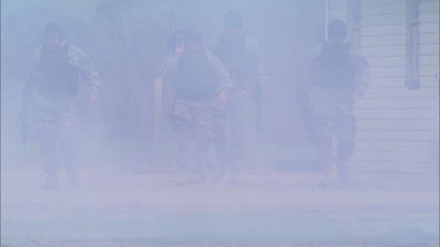MS, Soldiers walking in smoke, USA