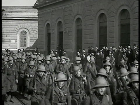 soldiers walking in street in parade formation. soldiers walking w/ pack mules. - 1935 stock videos & royalty-free footage