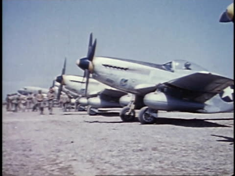soldiers walking near airplanes parked at airfield / iwo jima, japan - iwo jima island stock videos & royalty-free footage