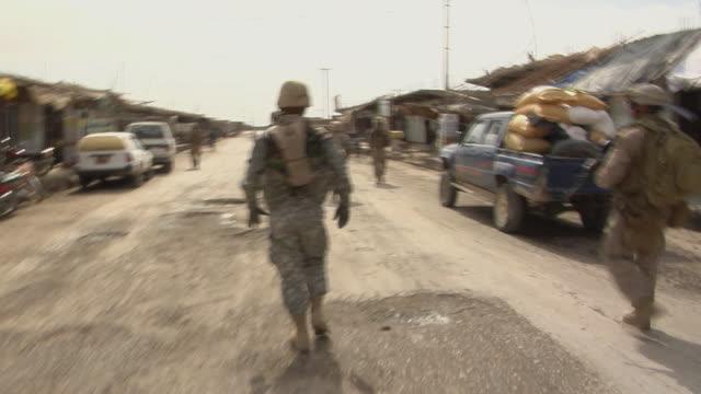 stockvideo's en b-roll-footage met soldiers walking on road / musa qala helmand province afghanistan - vertaling