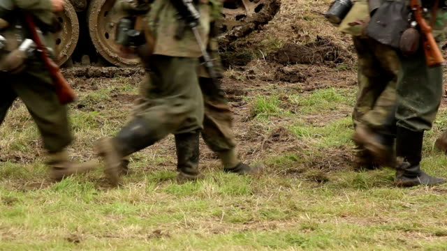 soldiers walking through a field - marching stock videos and b-roll footage