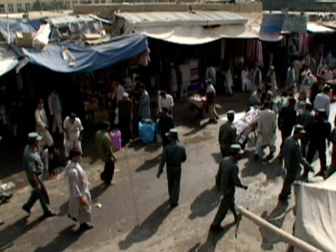 t/l ha ws soldiers walking through fair, kabul city, kabul, afghanistan - fairground stall stock videos & royalty-free footage