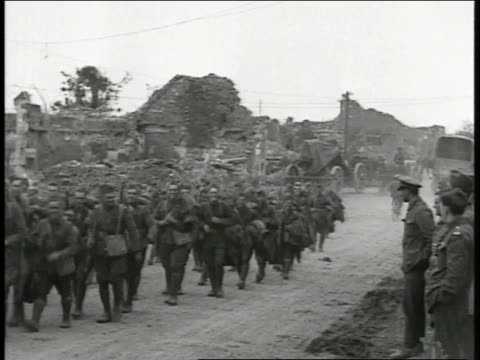 soldiers walking together down dirt road, bombed town rubble bg. - 1918 stock videos & royalty-free footage