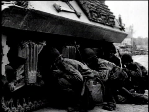 ls soldiers walking towards a town / cu soldier crouched with rifle / ls smoke from an explosion / ms soldiers hiding behind a tank / ls explosion /... - la manche stock videos and b-roll footage