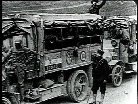 wwi soldiers wave hats and hands toward camera before departing in automobiles / france - 1918 stock videos and b-roll footage