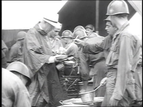 soldiers wearing rain ponchos and helmets - 1951 stock videos & royalty-free footage