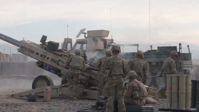 Soldiers with 1st Battalion 76th Field Artillery Regiment 4th Infantry Brigade Combat Team 3rd Infantry Division fire the M777 Howitzer in order to...