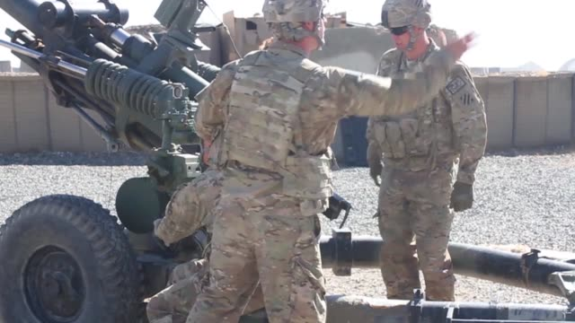 soldiers with 1st battalion, 76th field artillery regiment, 4th infantry brigade combat team, 3rd infantry division, fire the m119 howitzer in order... - howitzer stock videos & royalty-free footage
