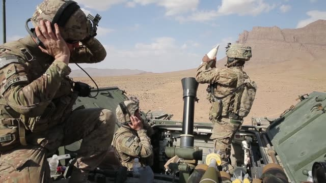 stockvideo's en b-roll-footage met ms soldiers with 4th squadron 2d cavalry regiment participate in a livefire exercise with 120mm mortars in the desert on march 6 2014 near kandahar... - kandahar afghanistan