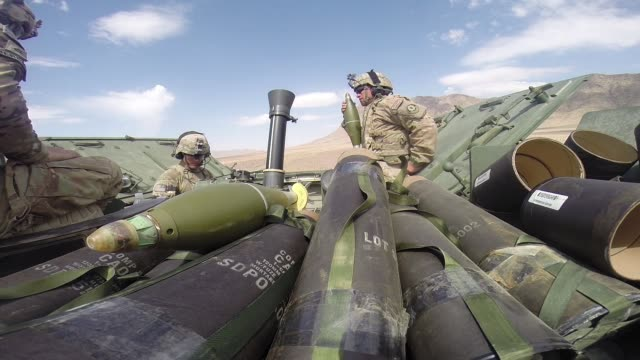 stockvideo's en b-roll-footage met la ls soldiers with 4th squadron 2d cavalry regiment participate in a livefire exercise with 120mm mortars in the desert on march 6 2014 near... - kandahar afghanistan