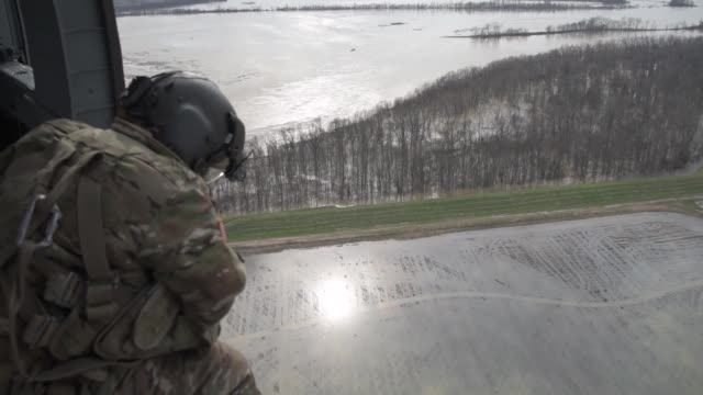 soldiers with arkansas national guard assist jackson county road department filling in weak areas along the county's levee - national guard stock videos and b-roll footage