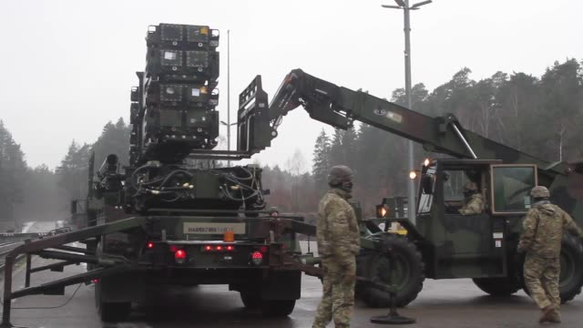 soldiers with d battery, 5th battalion, 7th air defense artillery regiment upload patriot missile launchers near baumholder, germany february 7, 2019. - 弾薬点の映像素材/bロール