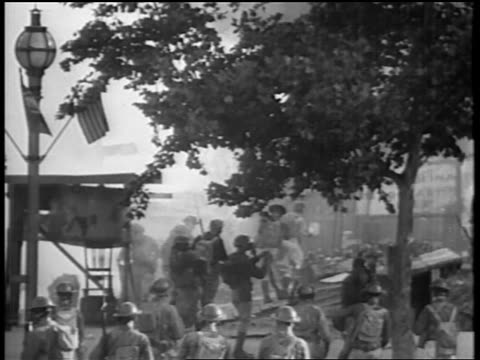 s soldiers with gas masks standing around campground / bonus march / washington dc - 1932 stock-videos und b-roll-filmmaterial