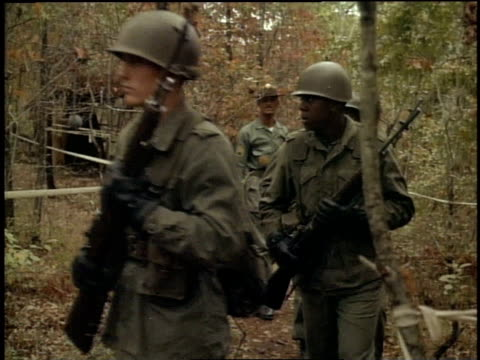 1967 montage soldiers with guns being lead by soldier in red hat through woods for practice drills / fort campbell, kentucky - fort campbell video stock e b–roll