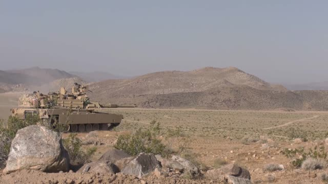 soldiers with idaho army national guard conduct live fire training exercise with m1a2 abrams battle tanks and m2a3 bradley fighting vehicles at fort... - tank stock videos & royalty-free footage