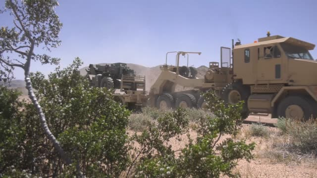 soldiers with idaho army national guard convoy to their positions at the national training center fort irwin california on 31 may 2019 - infanterie stock-videos und b-roll-filmmaterial