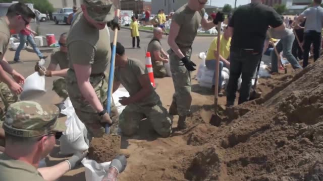 soldiers with illinois national guard assist volunteers and members of the community to fill and load sandbags in qunincy illinois in response to... - sandbag stock videos & royalty-free footage