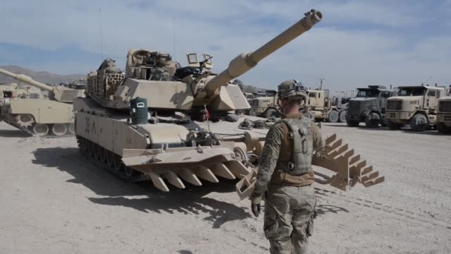 soldiers with north carolina national guard deployed for operation hickory sting load up and move out of national training center fort irwin... - infanterie stock-videos und b-roll-filmmaterial